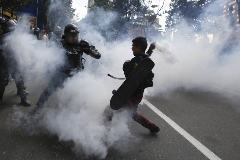 Police and protestors clash on Sunday in Bogota.