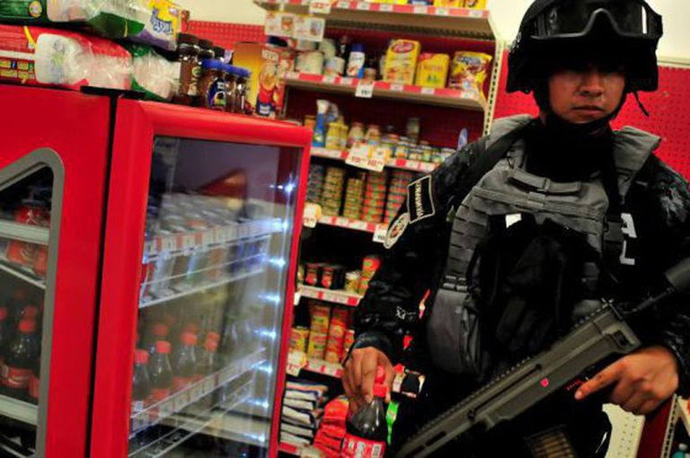 A soldier inside a store in Guerrero state.