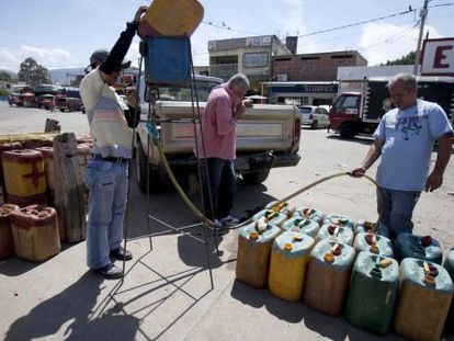 Smugglers filling up gasoline tanks on the Colombian side of the border with Venezuela in 2009.