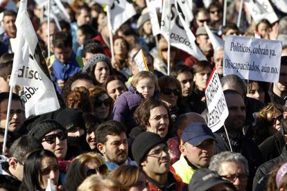 Thousands of people marched in Madrid on Sunday to protest government cuts to funds allocated to help disabled citizens.