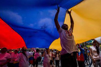 Marchers protesting violence in Venezuela, whose regime Podemos has failed to criticize.