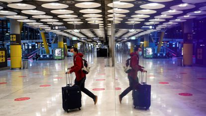 A traveler at Madrid's Barajas Airport on Wednesday.