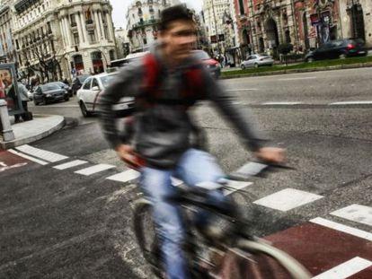 A cyclist rides the bike path on Alcalá street.
