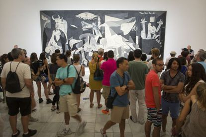 Visitors milling in front of Picasso's famous mural 'Guernica', at Reina Sofía