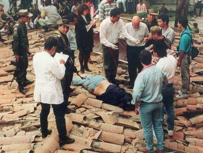 Police view the body of Pablo Escobar after he was gunned down by Colombian authorities in 1993.