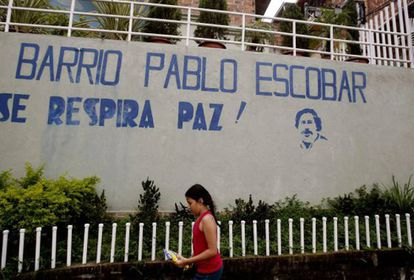 """Pablo Escobar's neighborhood in Medellín. """"Peace is in the air,"""" reads the graffiti."""