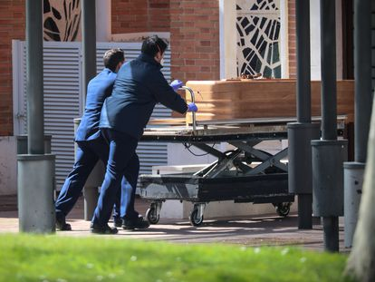 The coffin of a coronavirus victim in La Almudena cemetery in Madrid.