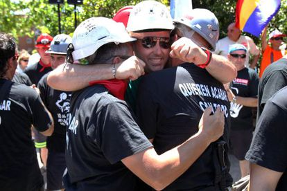 Jubilant miners arrive in Alcobendas, to the north of the capital, on Monday.