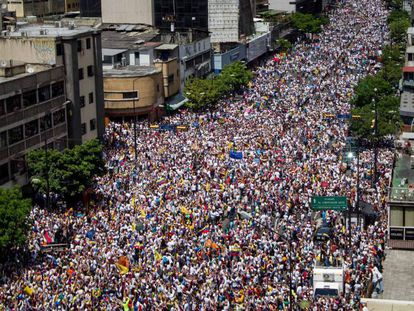 Thousands of people march on the streets of Caracas.