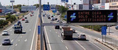 """""""Only justified travel allowed between regions,"""" reads this sign on the S30 highway to Seville."""
