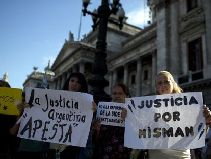 People hold a vigil outside Congress in support of Nisman.