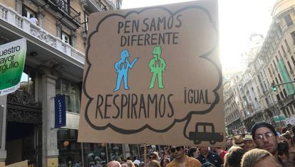 "Protest to protect Madrid Cental on July 6. Sign reads: ""We think differently, we breathe the same."""