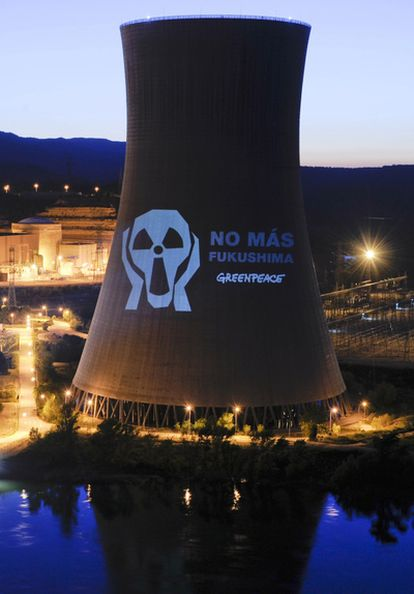 Greenpeace activists project an anti-atomic message on the side of the Ascó nuclear power station in Tarragona.