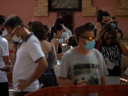 Members of the public wait for coronavirus tests in Villafranca del Panadés, Catalonia.