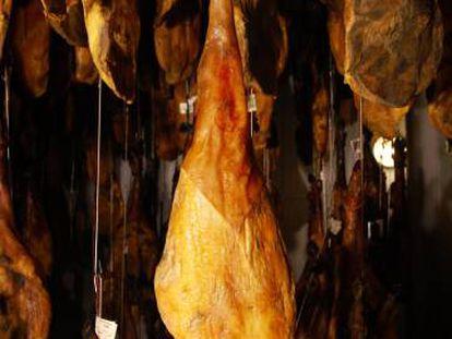 Ham legs being cured at Embutidos Fermín.