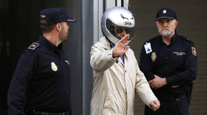 González Pacheco, wearing a motorcycle helmet, leaves court in a file photo from 2014.