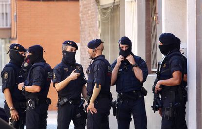 Mossos d'Esquadra officers on Monday outside the attacker's apartment.