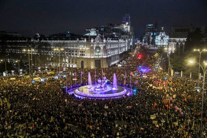 The Madrid marchers pack out Cibeles square and Alcalá street.