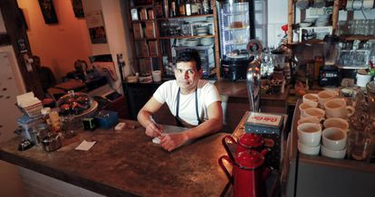 Julio Grisales works long hours at his Madrid coffee bar.
