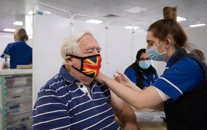 An elderly man receives the AstraZeneca-Oxford coronavirus vaccine in Stevenage, in the United Kingdom last month.