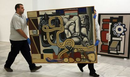 Workers ready the exhibition of Kunstmuseum works at the Reina Sofía.