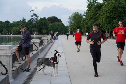 Carlos, with his dog Aika, by the lake in El Retiro on Monday.