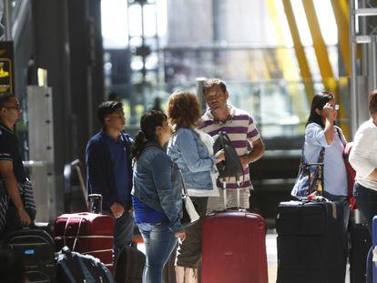 People at Madrid's Barajas Adolfo Suárez airport.