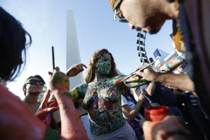 """Some women painted their bodies with messages such as """"I decide."""""""