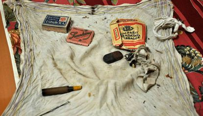 A scarf holds the small things that Heliodoro Meneses carried in his pocket the day of his execution.