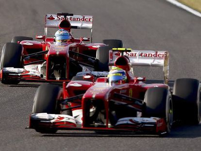 Felipe Massa (front) and Fernando Alonso joust during the Japanese Grand Prix.