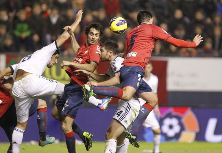 Xabi Alonso (center) is caught in a melee during Real Madrid's match against Osasuna.