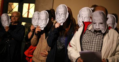 Residents of Barcelona's Raval district protest against local politicians' silence on the killing of Benítez by wearing masks resembling the victim.