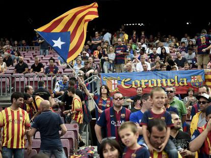 A Barça fan waves an 'estelada' Catalan nationalist flag at Camp Nou.