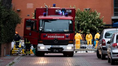 Firefighters disinfect the Monte Hermoso senior residence in March.