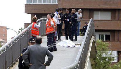 Police and paramedics next to Carrasco's body in León.