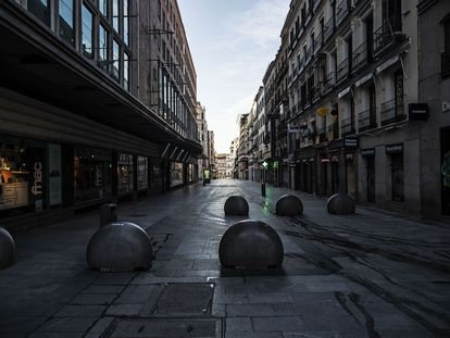 Preciados street in Madrid, normally packed with shoppers and tourists, deserted under the lockdown.