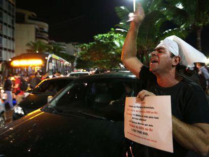 A protestor shouts outside the home of Rio de Janeiro Governor Sergio Cabral on Thursday.