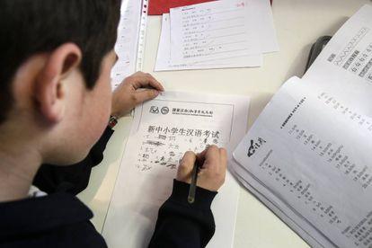 Antonio Martín, nine, practices Chinese characters at an academy in Pozuelo de Alarcón.
