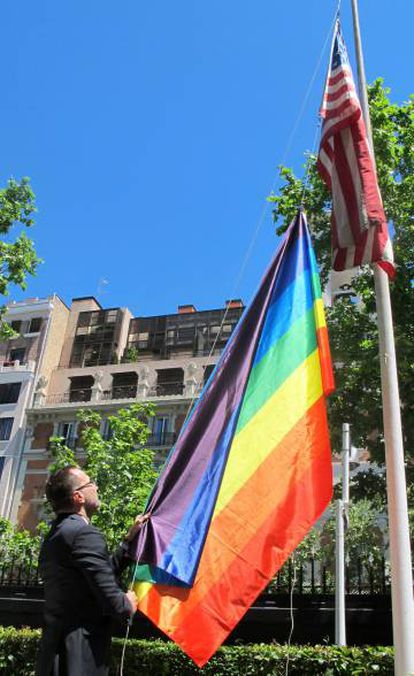 Costos hoists the multicolored flag at the US embassy in Madrid to inaugurate the LGBTQ Pride month.