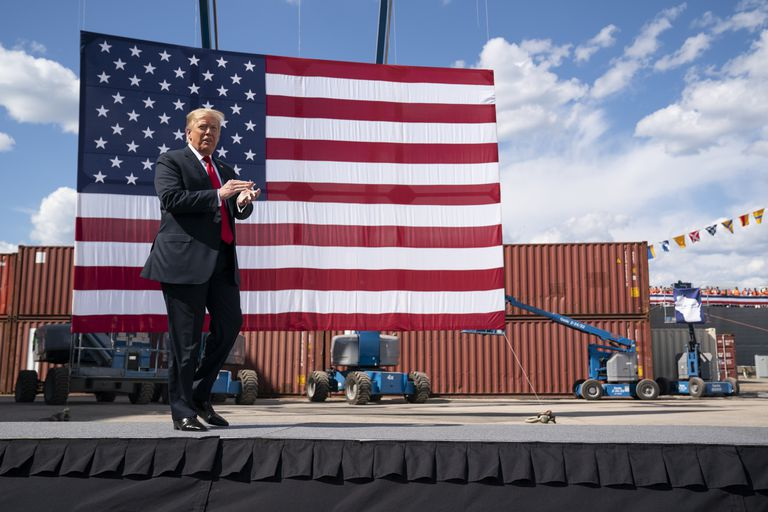 President Donald Trump arrives to speak in Marinette, Wisconsin on June 25.