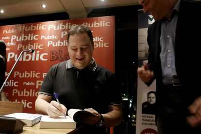 Pablo Escobar's son signs a copy of his book about his father.