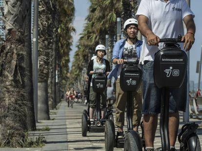 Tourists on a segway tour of Barcelona.