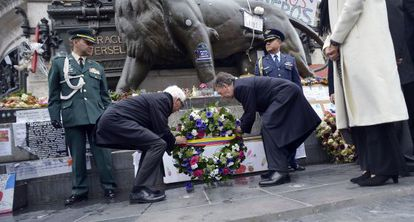 Santos (right) at a ceremony to pay tribute to victims of terrorism in Paris.