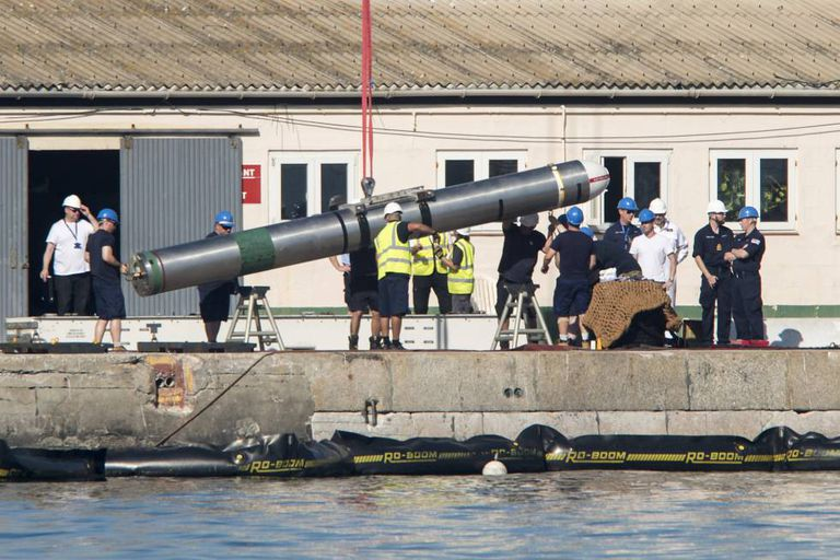 Technicians removing a missile from HMS Ambush in the port of Gibraltar.