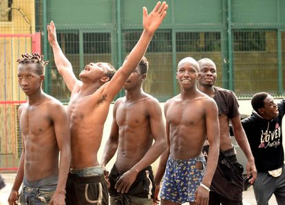 African migrants celebrate as they enter the CETI immigrant center in Ceuta.