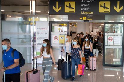 Tourists arrive at the Son Sant Joan airport in Palma de Mallorca on July 8, 2020.