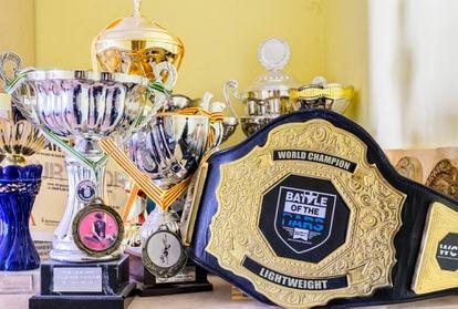 Jiménez's trophy collection, including the world champion belt.