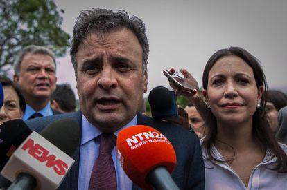 Brazilian Senator Aécio Neves and Venezuelan opposition leader María Corina Machado speak to reporters in Caracas on Thursday.