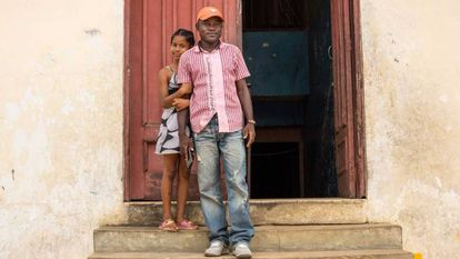 Jospeh Duo, a former child soldier in Liberia, with his daughter.