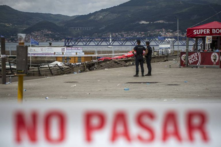 Scene the day after a seaside boardwalk collapsed during a nighttime concert in Vigo.
